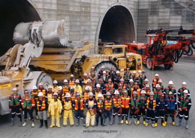 Redpath employees pose at a tunnel project site in Indonesia.
