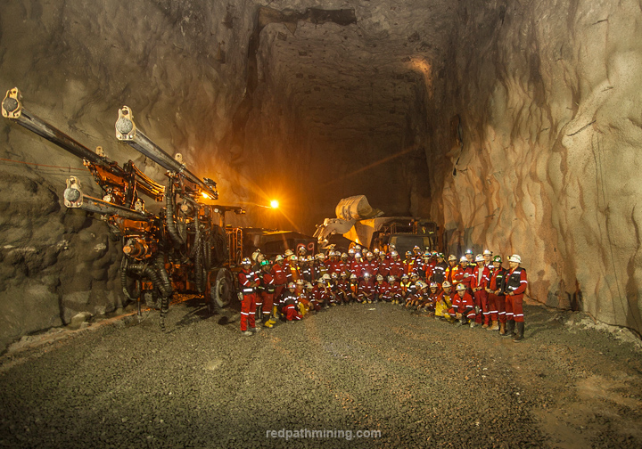 The Redpath team poses in front of equipment during crusher chamber development in the Grasberg Block Cave (GBC) Mine, in Indonesia.
