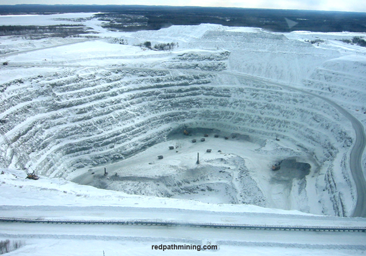 An aerial view of an open pit mine site.