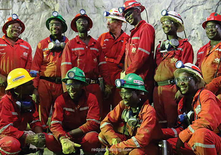 A group of employees pose on-site at Mopani Copper Mines in Africa.