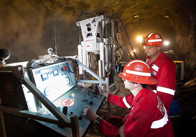 Two Redpath employees operate equipment underground at Golden Grove in Australia.
