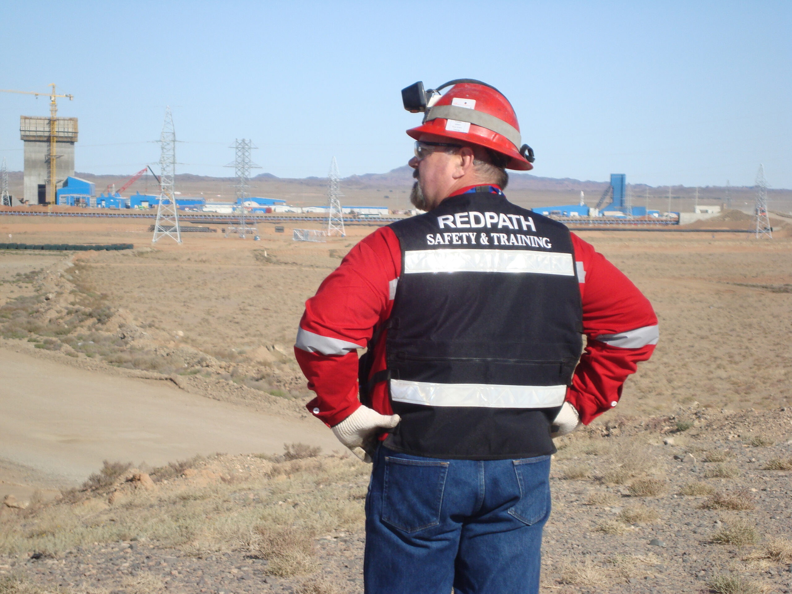 Close-up of a Redpath employee's safety & training jacket from the back.