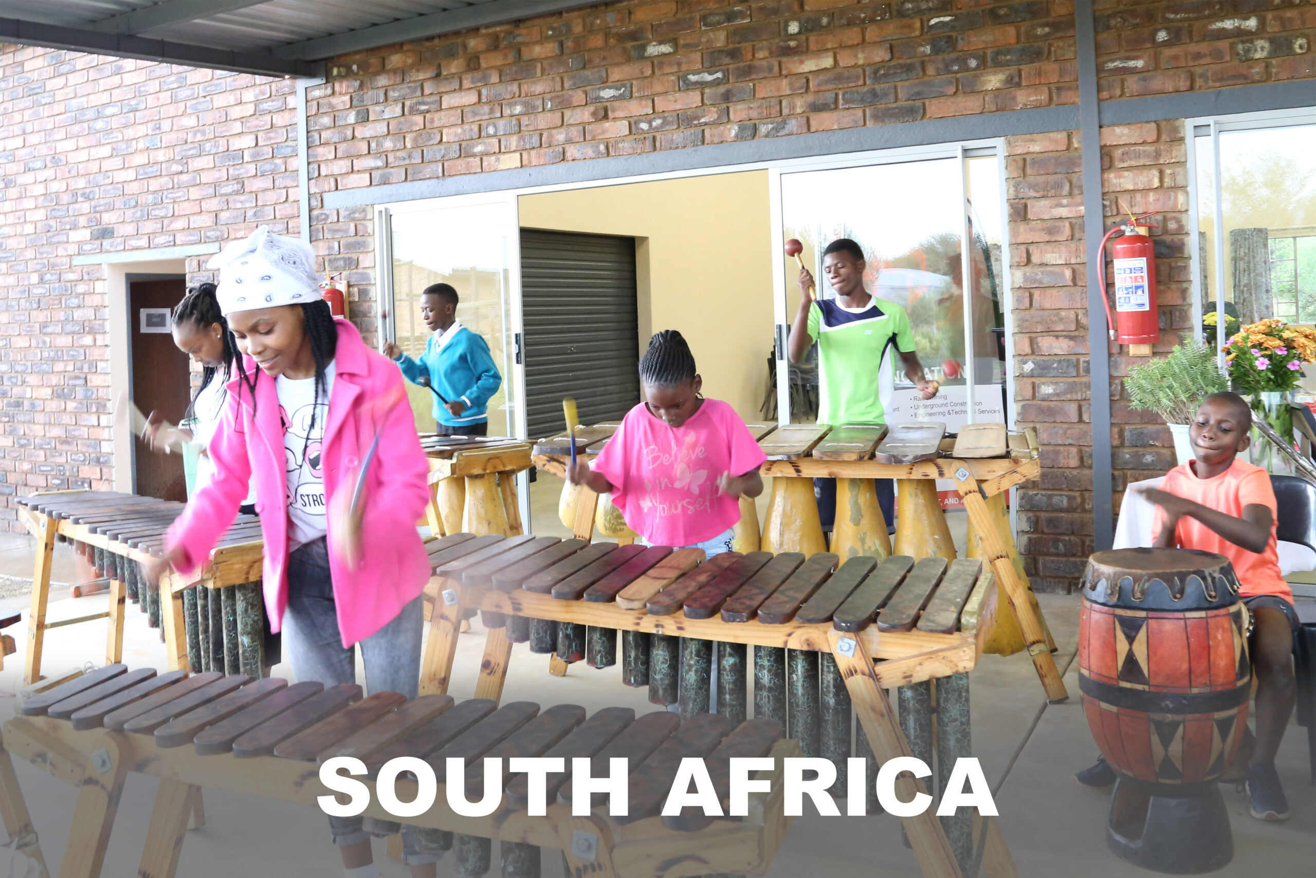 A group of community members perform a musical number during the Thabang outreach effort